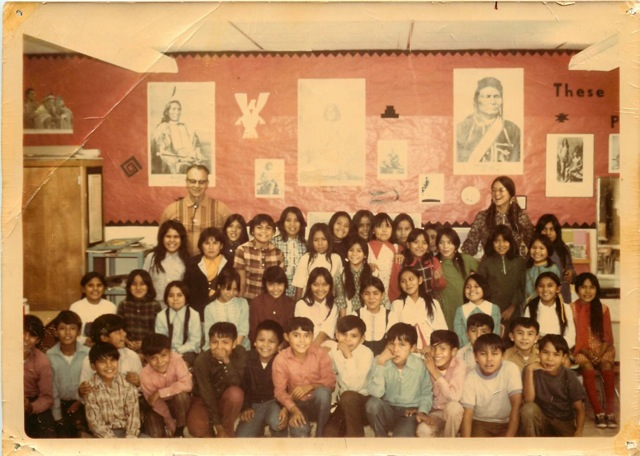 Erica standing in the back to the right with her 4th grade classroom. Chinle, Arizona. 1971.
